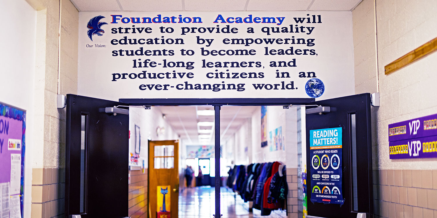 Entrance to Foundation Academy hallway painted with the school vision statement.