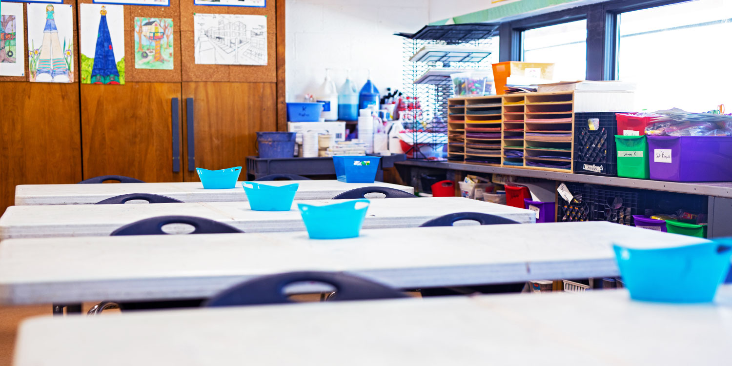 Tables and art supplies in the art room.