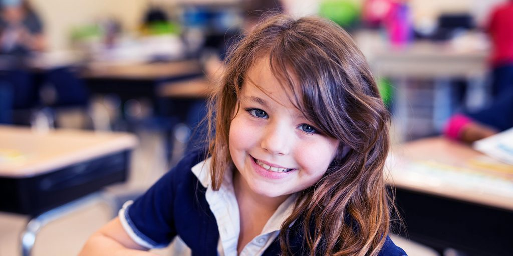 Smiling elementary student.